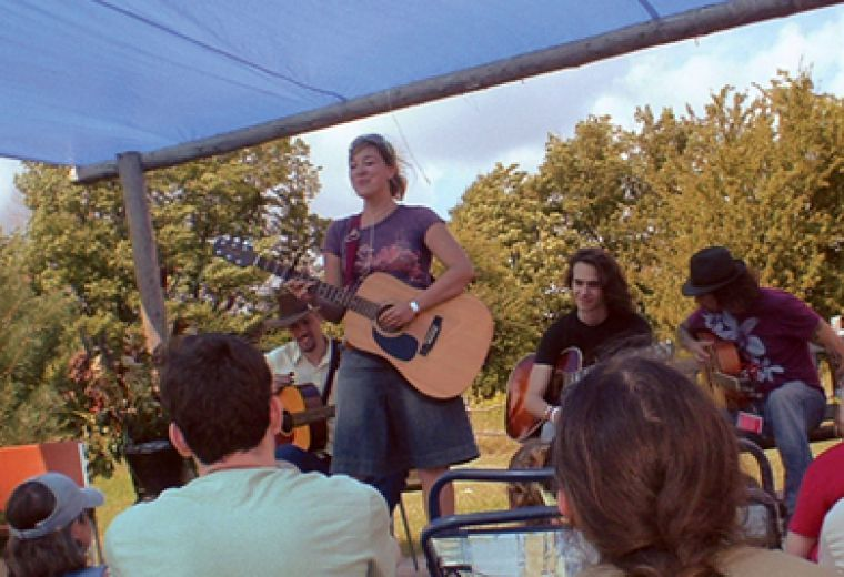 Festival goers take in Queen's graduate Jill Barber's set at the second annual Shelter Valley Folk Festival held in Grafton, ON.