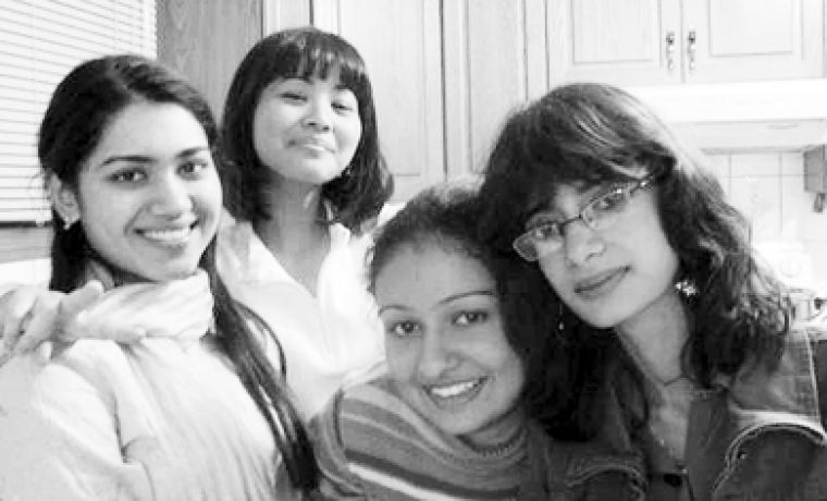 Sukaina Mohsin Ali, far right, poses with friends. Ali died in her dorm room April 10, 2006.