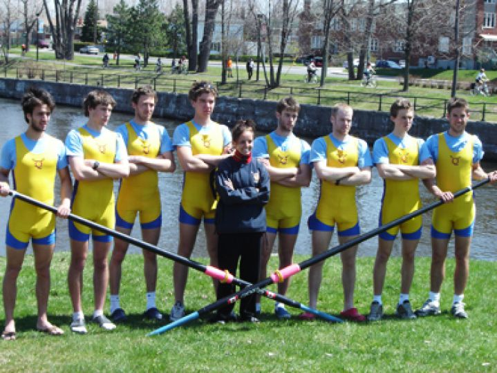 The varsity men's crew strikes a victory pose after sweeping their events in Montreal on April 30, 2006.