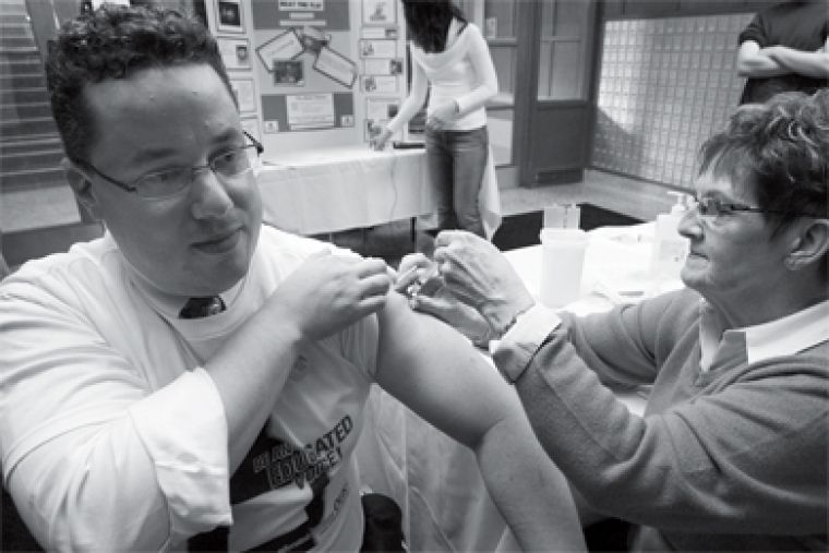 Dean of Student Affairs Jason Laker got a flu shot in Victoria Hall Wednesday in order to promote shots for students. Students can get vaccinated next week at HCDS if they bring their student card and health card.