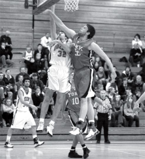 Gael Mitch Leger (32) fights for a rebound during last Friday's game againt the York Lions.