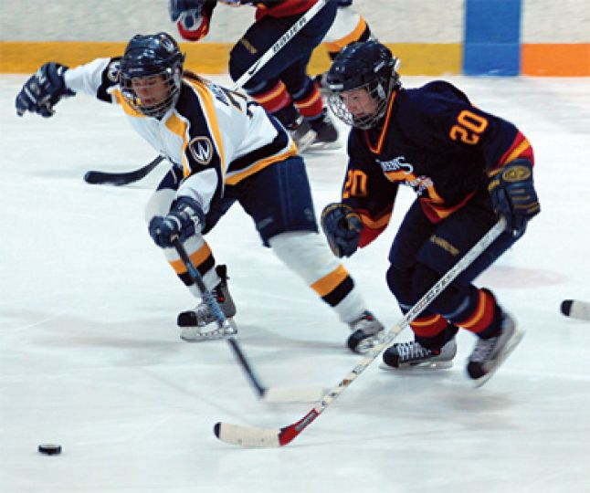 Queen's races Windsor for the puck at home on Sunday.