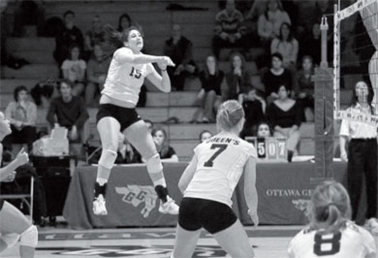 Lousie Hamill (15) goes in for the kill in Saturday's game against the Ottawa Gee-Gees. The Gaels lost in straight sets.