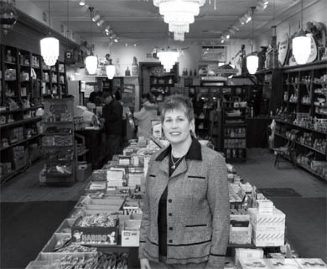 Susan Cooke purchased Cooke's Fine Foods in 1991 from her grandfather, Hugh Cooke, who worked in the store for 14 years before buying it in 1924.