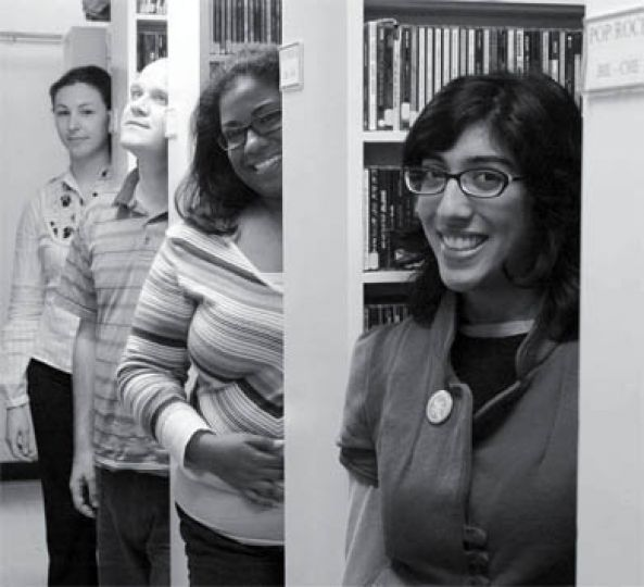 Left to right: CFRC staff Joanne Williams, Scott Stevens, Sirena Liladrie and Sayyida Jaffer stand in the CD stacks of the CFRC music library in the basement of Carruthers Hall.