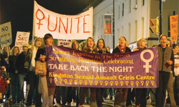 More than 50 women marched to take back Kingston's streets Friday night.