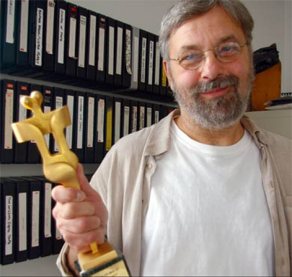 Film professor Clarke Mackey holds his Canadian Film Award for his 1971 debut feature.