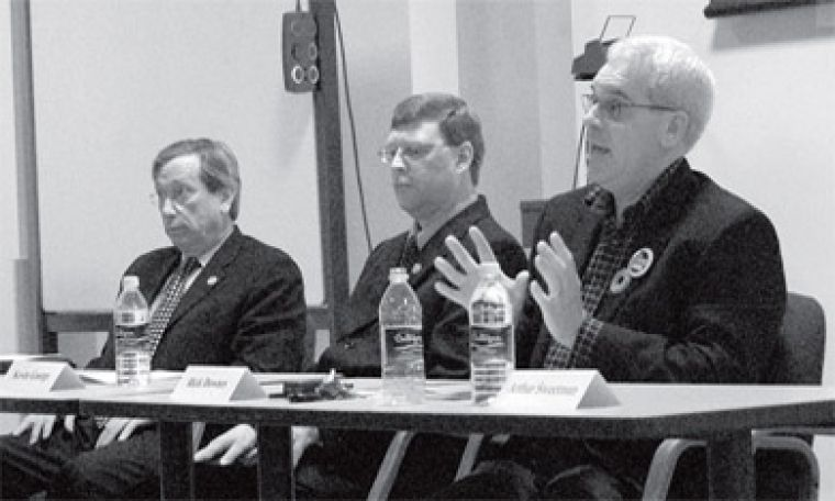 Left to right, incumbant Harvey Rosey, Kevin George and Rick Downes debate on Friday.