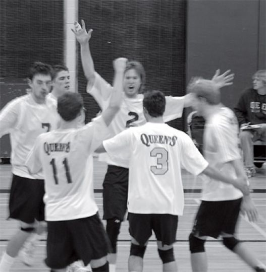 Players congratulate each other after a point against Western.
