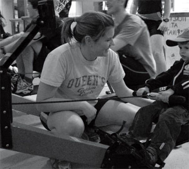 Women's captain Buzzy McCord teaches Jack how to use an ergometer.