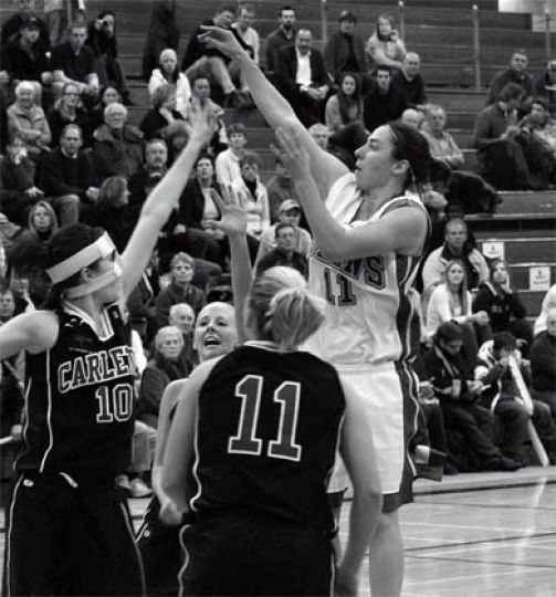 Claire Meadows (in white) shoots for the hoop during a 58-54 win over Carleton on Friday.