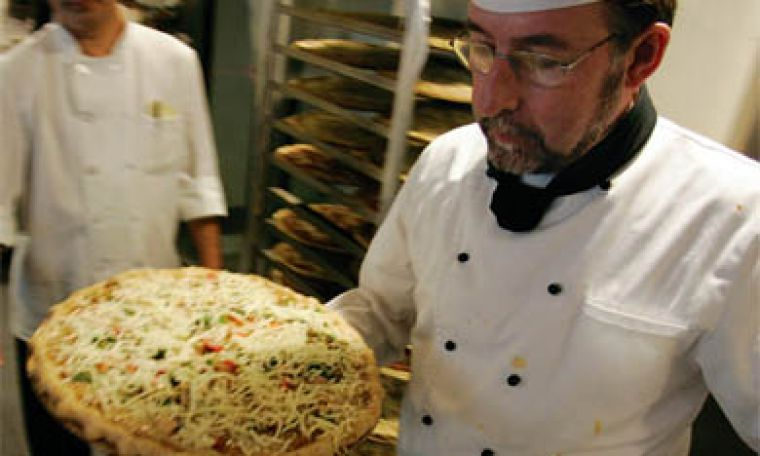 Leonard Cafeteria's executive chef John Saunders hard at work. See story page 4.