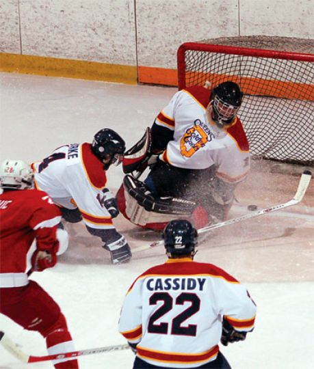 Queen's defenders deflect a puck into their own net Friday.