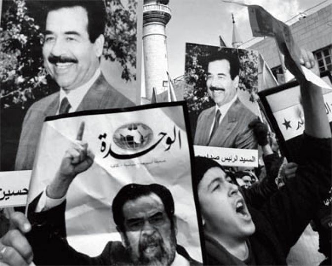 Jordanian protesters shouts slogans against the radical Shiite cleric Muqtada Al-Sadr and hold pictures of Iraqi former leader Saddam Hussein during a rally in Amman, Jordan, after the Friday prayers, Jan. 5, 2007. Some 3,000 Jordanians marched in down town to protest against the execution of former Iraqi President Saddam Hussein.