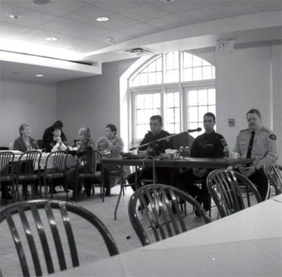 Police officers speak at a symposium Sunday hosted by Four Directions Aboriginal Centre.
