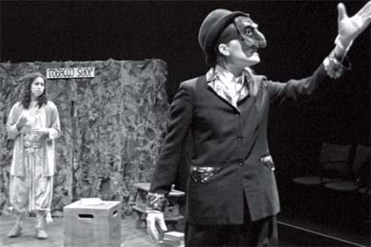 The spare set emphasized the actors' costumes.