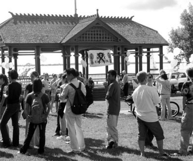 Students gather at the 2003 Kingston AIDS Walk in City Park. This year's walk will be held on Saturday at 6 p.m. at the same location.