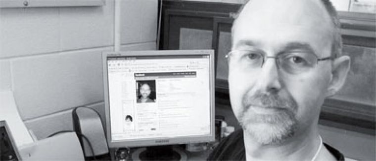 Computer sciences professor Robin Dawes has an account on Facebook that he uses to respond to friend invitations.