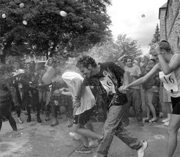 Engineers pelt other frosh with water balloons in front of Grant Hall.