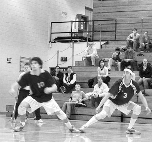 Hamilton, right, and Queen's teammate Peter Galbraith prepare to receive the ball during the 2005-06 regular season.