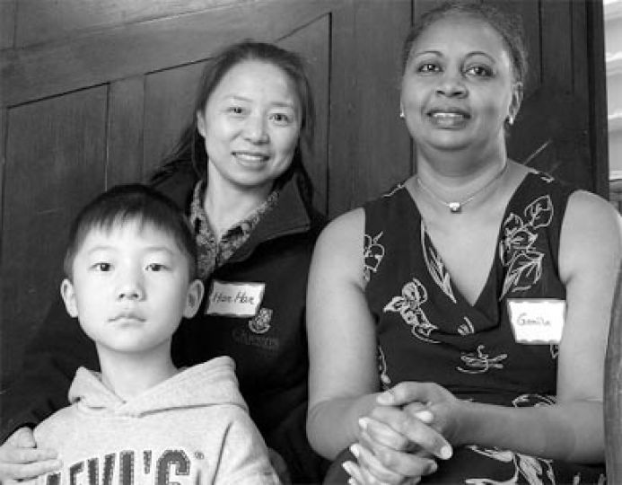 Various awards were handed out at the 2005 Ban Righ Centre Spring Award Ceremony. Han Han, middle, recipient of the 2005 Barbara Hall Memorial Award, sits with her son and Gamila Abdalla, student advisor, during a pause in the pre-show reception.
