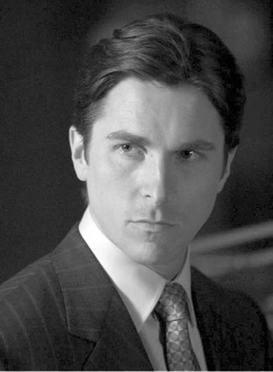 "Christian Bale, as Bruce Wayne in Batman Begins, portrays the Dark Knight in a ""primly smouldering"" fashion."