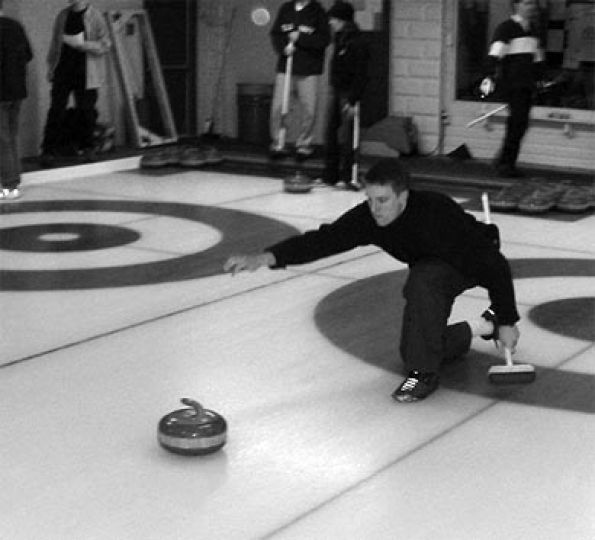 The intramural curling league hits the ice at the Royal Kingston Curling Club in 2002.