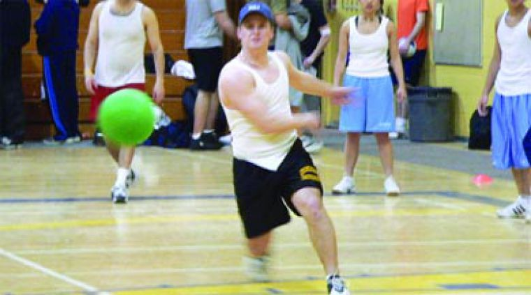 A student lets the ball fly in the intramural dodge ball tournament.