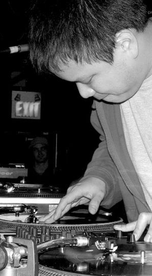 Kid Koala caresses his beloved turntables.