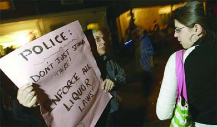 Canadian Action Party member and Kingston resident Don Rogers protests police inaction.