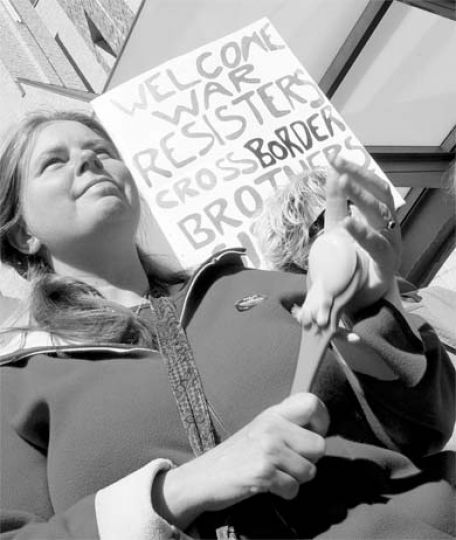 A protester shows her support at Saturday's anti-war rally.