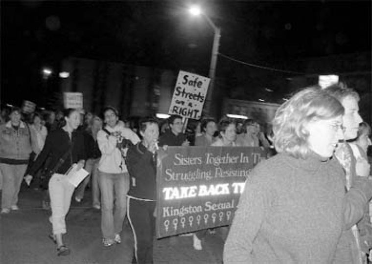 Women of all ages marched through downtown Kingston for Take Back the Night.