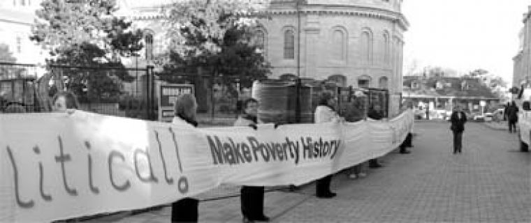 A crowd of 300 people wound a white banner around City Hall on Monday to protest poverty.