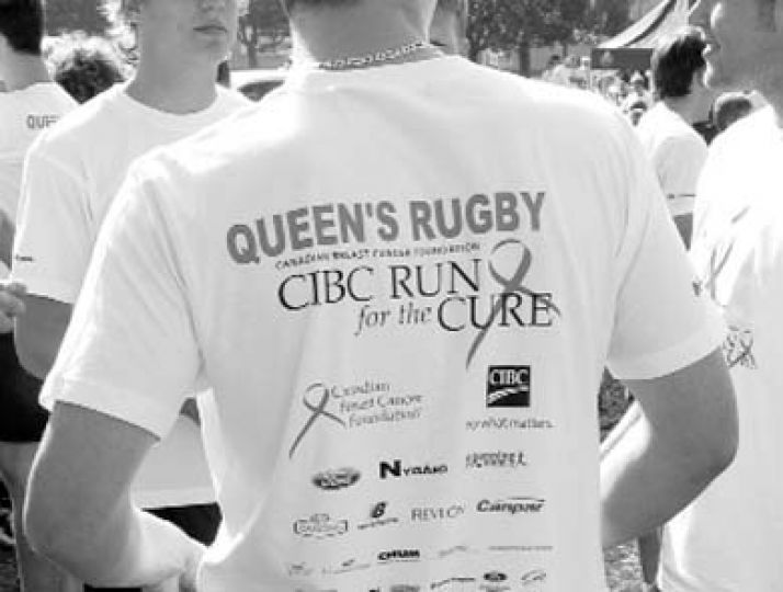 Men's rugby march together for breast cancer research.