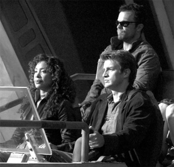 Cast members of Serenity take a leisurely drive through the galaxy.
