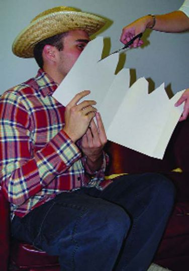 Find a small piece of cardboard and make a fence to carry in front of your face.