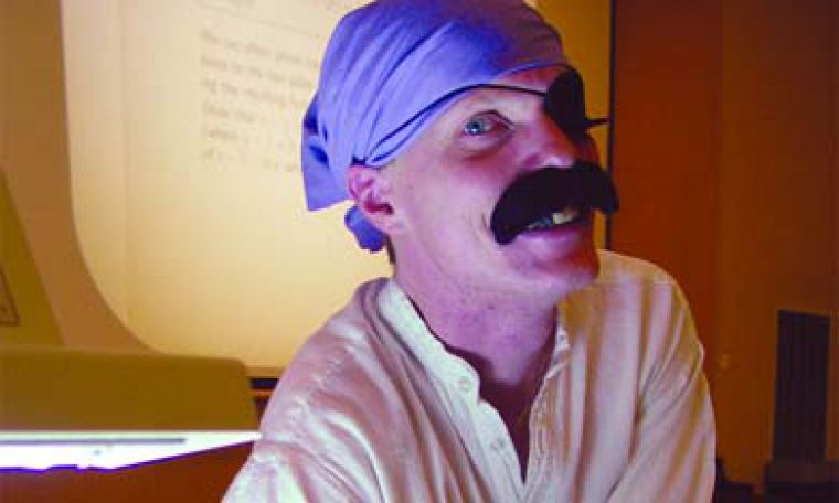 Mathematics professor Geoff Ableson wore a Halloween costume to his lecture class on Monday to raise money for South Asian earthquake relief. The two sections of his class raised $545.24. Other professors on campus also dressed up this week to fundraise for the cause.