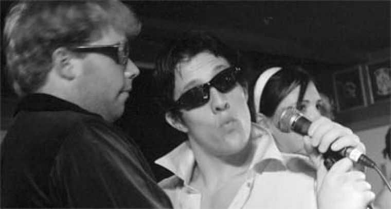 Elton John, Tom Cruise and Veronica (of Archie fame) have their game faces on in The Passion of the Ice: Cruisified.