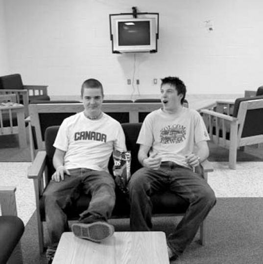 Brennan Mercer and Dave Wilson, both ArtSci '09, sit in the lower Victoria Hall common room, which was recently redone.