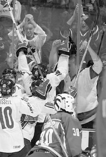 Steve Downie is embraced by Canadian fans after scoring the gold-medal-winning goal against Russia.