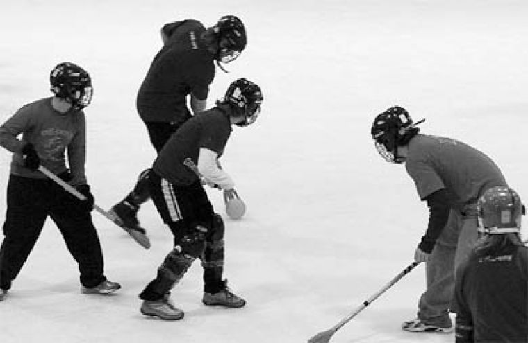 Defenders counter offensive attacks from BEWIC foes during broomball.