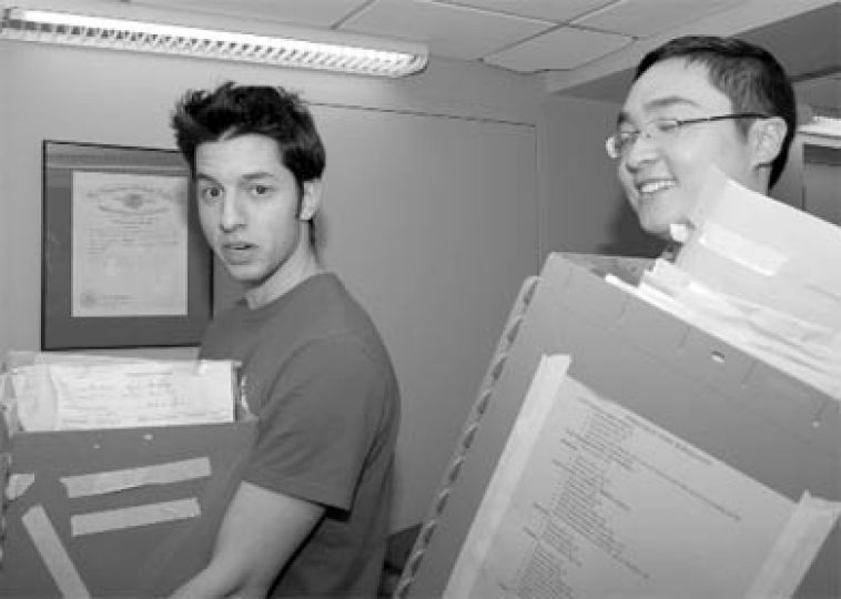 Ryan Yoannou, deputy returning officer and Kingsley Chak, undergraduate trustee, rush back to the AMS offices to count ballots from the winter election and referendum last Wednesday.