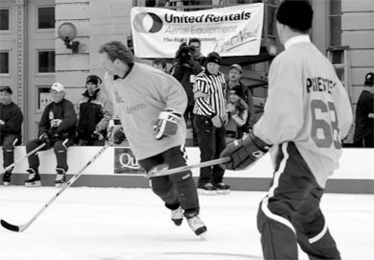 Queen's men's hockey head coach Kirk Muller and actor Jason Priestley hit the ice Saturday for the Queen's University team.