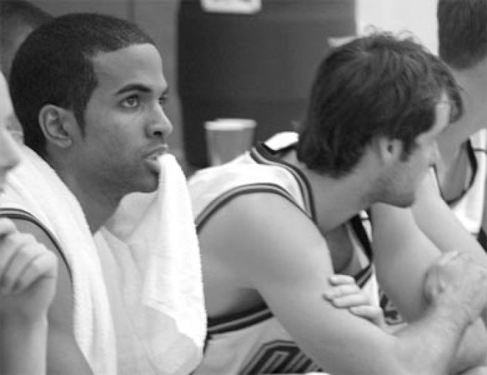 Gaels guard Jonathan Daniels looks on with concern from the bench.