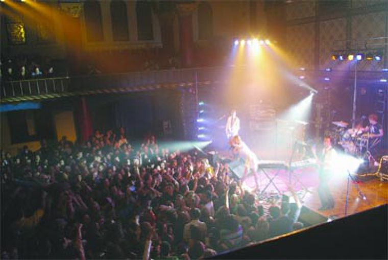 Crowd members pumped their fists for Metric at its second appearance this year on Tuesday night at Grant Hall.