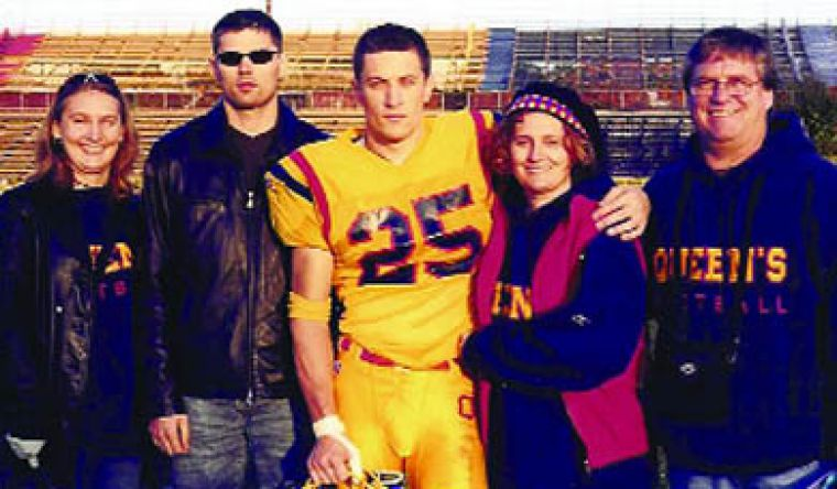 The late Justin Schwieg (centre) with his stepsister Caitlin, brother Jay, mother Christine and stepfather Terry (left to right) after Schwieg's last game as a Golden Gael.