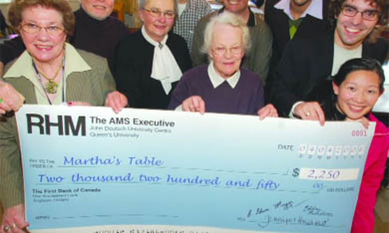 AMS executive members fulfilled their pledge to donate five per cent of their salaries to Martha's Table if they didn't fulfill all their campaign promises.