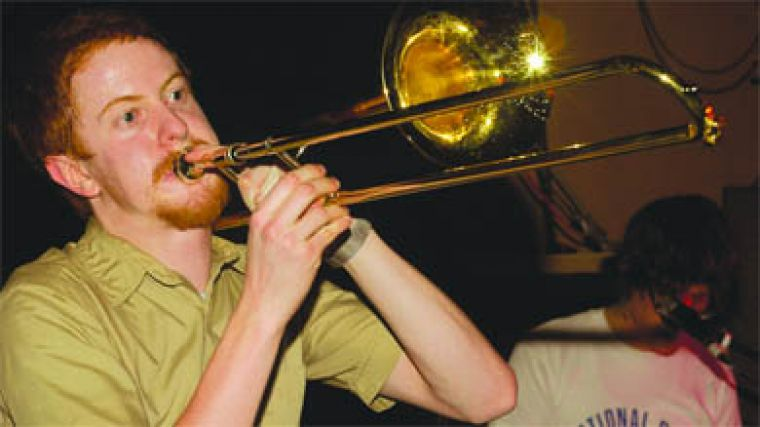The Most Serene Republic's Adrian Jewett gets brassy during their set last Monday night.