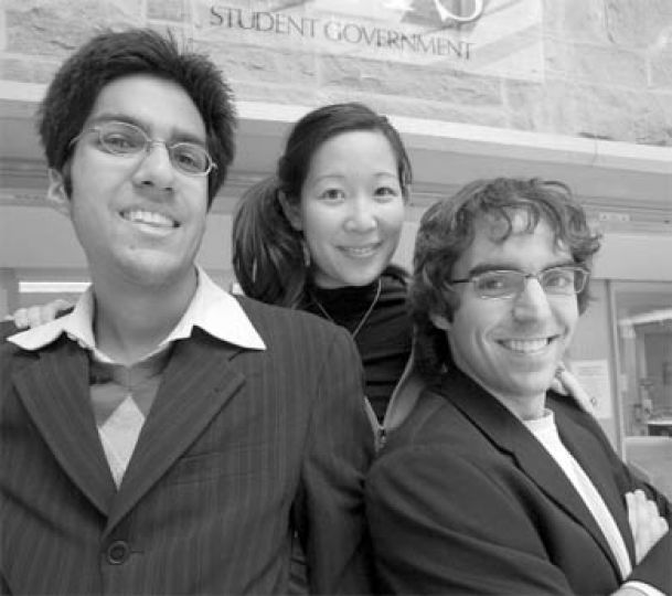 Shiva Mayer, AMS VP (University Affairs), Jenn Hirano, AMS VP (Operations), and Ethan Rabidoux, AMS president, pose in front of the AMS offices in the JDUC.