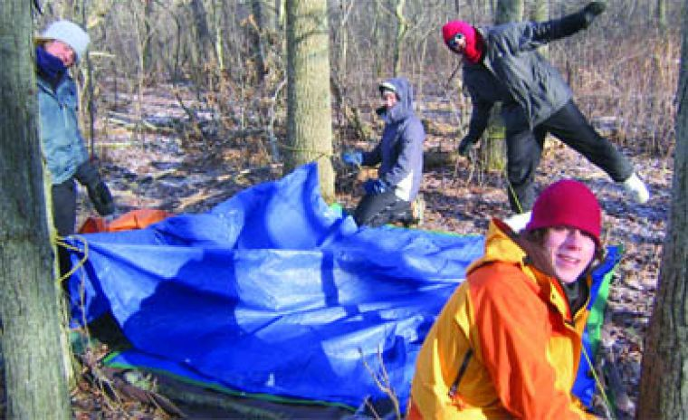 Winter Outlook counsellors Sarah Cart, Katie Quinn, Farron Blanc and Joe Oliver (L to R) set up camp.